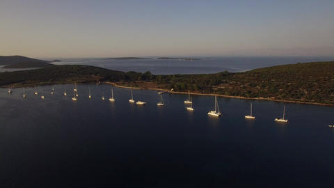 Aerial - Sailboats in safe anchorage Live Action