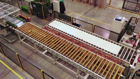 long sheet of metal transported by conveyor in plant shop Footage