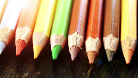 On a wooden background multi-colored pencils. Bright colored pencils Close up Footage