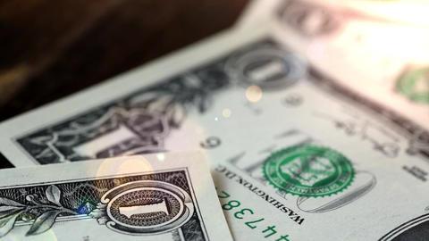 Dollar bills, money background. Dollars money lying on wooden table Portrait of Live Action