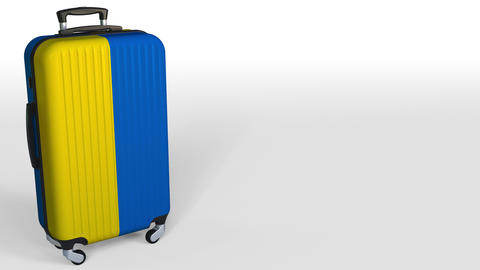 Traveler's suitcase with flag of Ukraine. Ukrainian tourism conceptual 3D Footage