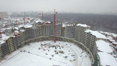 An aerial view of an empty building construction zone in a winter scenery Footage