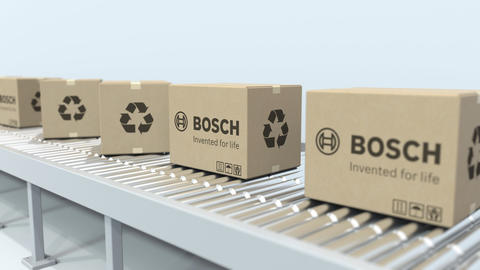 Boxes with BOSCH logo move on roller conveyor. Loopable editorial 3D animation Live Action