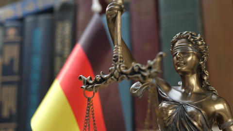 Statue of Lady Justice with Bookshelf with Books and Germany Flag Background Footage