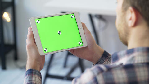 Businessman Holds in Hands and Uses Device With Touch Green Screen Live Action