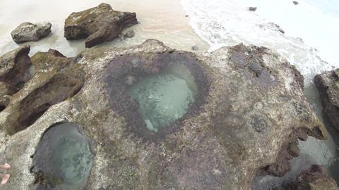 Heart-shaped tide pool at low tide at Akaogi district in Amami Oshima, Kagoshima, Japan Live Action