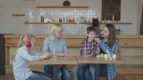 Single women with kids spending leisure in cafe Live Action