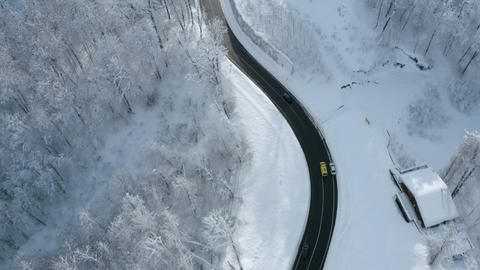 Aerial View of Snowy Forest with Ambulance on the Road Footage