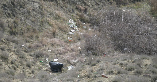 Nature is being littered by man Plastic is blown by the wind into the gorge Footage
