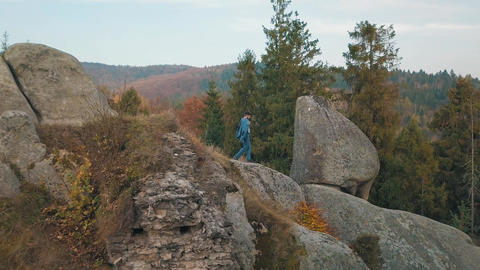 Young man on the hill of a mountain. Businessman. Bridegroom. Groom. Aerial Live Action