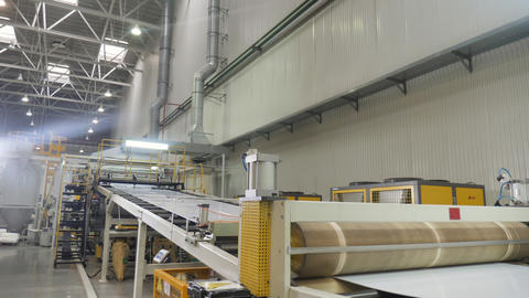 white material transported by conveyor in production shop Live Action