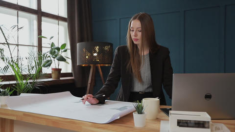 Female designer in office working on architects project Footage