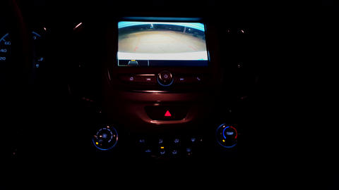 Car Rear View Camera While Vehicle Reversing at Night. Using the Backup Camera During the Evening Live Action