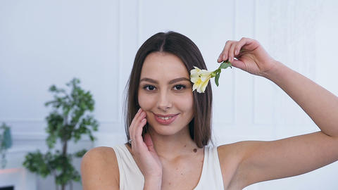 Portrait shot of attractive young woman with flower Footage
