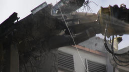 Demolition Excavator Arm Chipping Away Wall Debris Live Action
