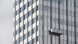Skyscraper Facade and Window Cleaners in Suspended Scaffold Footage