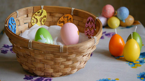 Colorful Easter Eggs green, yellow and pink In A Basket. Male hand adds one pink Footage