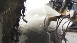 Demolition Machine Spraying Water on Crusher and Debris Live Action