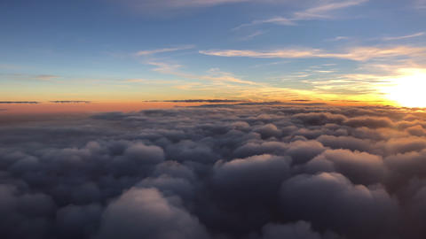 flying in the sky during beautiful sunset and thick clouds Footage