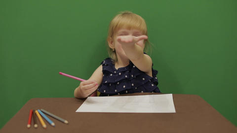 Girl sitting at the table. Education process. Cute girl... Stock Video Footage