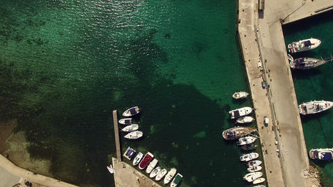 Aerial, vertical - Small port with moored boats Live Action