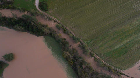 Aerial - Dirty river near the road. River channel flooding and overflowing Footage