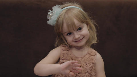 Happy three years old girl. Cute blonde child. Brown eyes. Cute girl smiling Footage