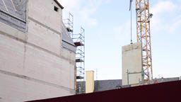 Concrete Panel Transported by Construction Crane on Site Live Action