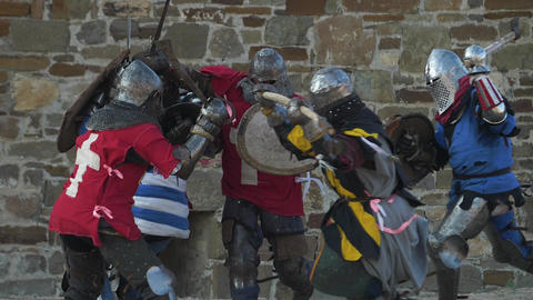 Fierce battle of knights against the castle walls Strikes with swords shields Footage