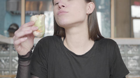 Portrait of pretty woman eating vegetarian food in the... Stock Video Footage