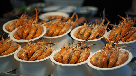 Delicious red prepared shrimp are served on their plates. Shrimp dish in Footage