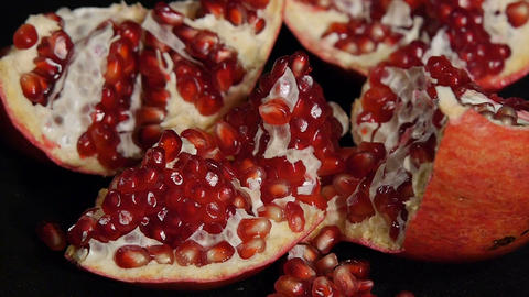 Delicious pomegranate. Portion of fresh made pomegranate. Fresh red pomegranate Footage