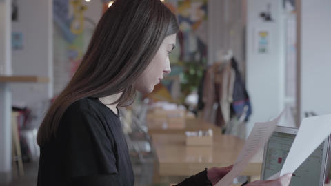 Beautiful successful busy girl in a black strict dress is looking at the papers Footage