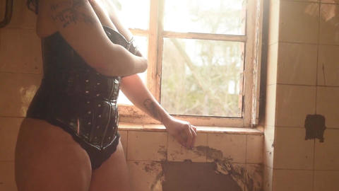 woman posing in front of old window backlit female nude model Footage