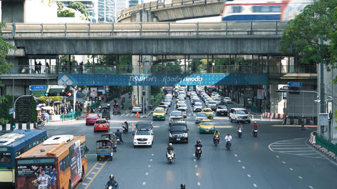 Traffic flow at a busy intersection in the metropolis. Car traffic at the Live Action