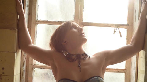 woman posing in front of old window backlit female nude model Live Action
