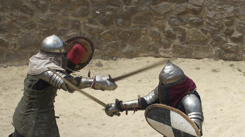 Two rival knights strike each other with the sword on the body for long Live Action