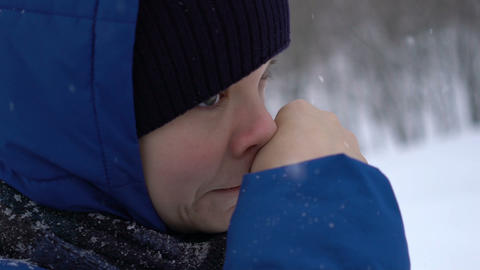 boy wipes his nose in the cold in winter Footage