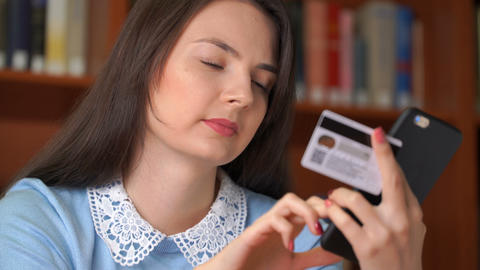 pretty woman shopping online with easy pay using smartphone and credit card Footage