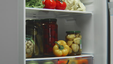 grey refrigerator full of food with opening and closing door Footage