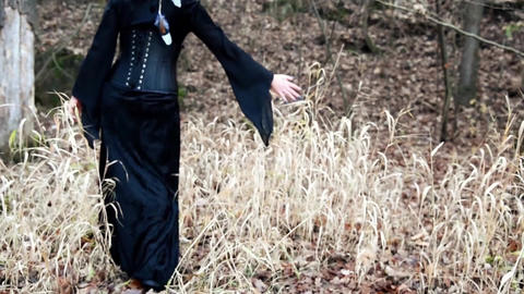 Viking woman strokes hands through reeds Live Action