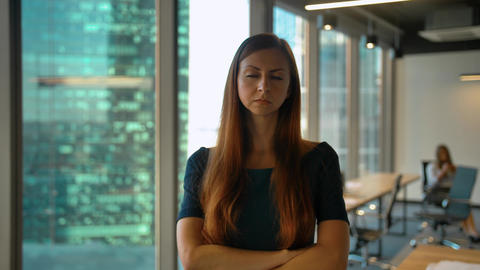 Portrait of young successful redhair businesswoman standing in office hall Footage