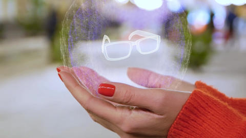Female hands holding hologram eyeglasses Footage