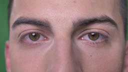 Closeup shoot of young handsome caucasian male face with eyes looking straight Footage
