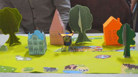 Orange house and green tree made of paper Archivo