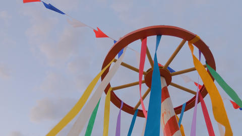 Decorative multicolor ribbons on wooden wheel construction Footage