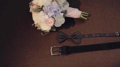 Beautiful wedding bouquet, groom's bow tie and belt. Wedding accessories Footage