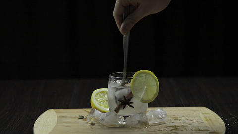 Mix with a spoon lemon cocktail. Refreshing alcoholic cocktail drink Live Action
