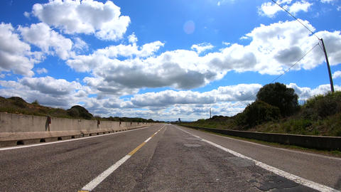 Driving in a beautiful cloudy and sunny day with cute clouds Footage