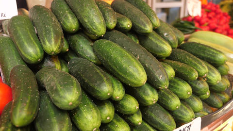 A pile of organic fresh cucumbers at the market Footage